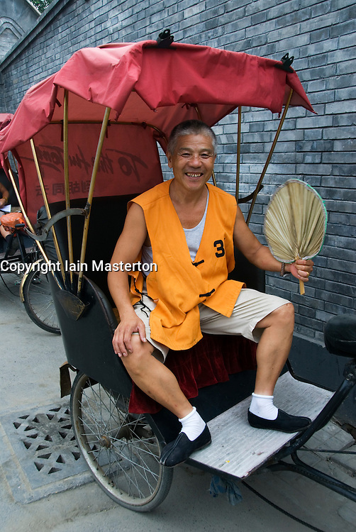 Rickshaw driver in a Beijing hutong
