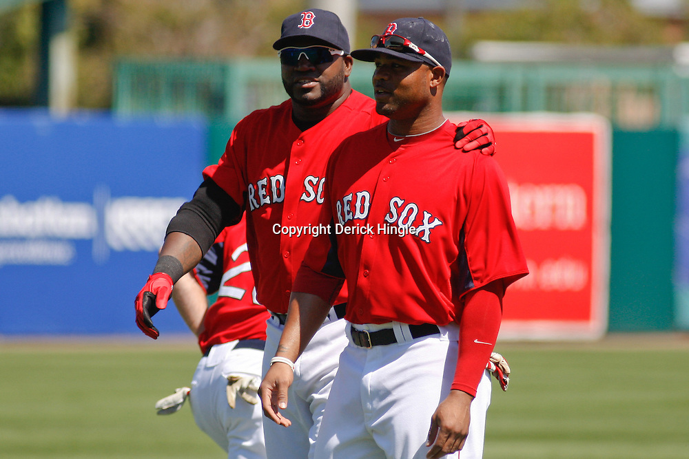 March 7, 2011; Fort Myers, FL, USA; Boston Red Sox first baseman David Ortiz (34) and left fielder Carl Crawford (13) before a spring training exhibition game against the Baltimore Orioles at City of Palms Park.   Mandatory Credit: Derick E. Hingle
