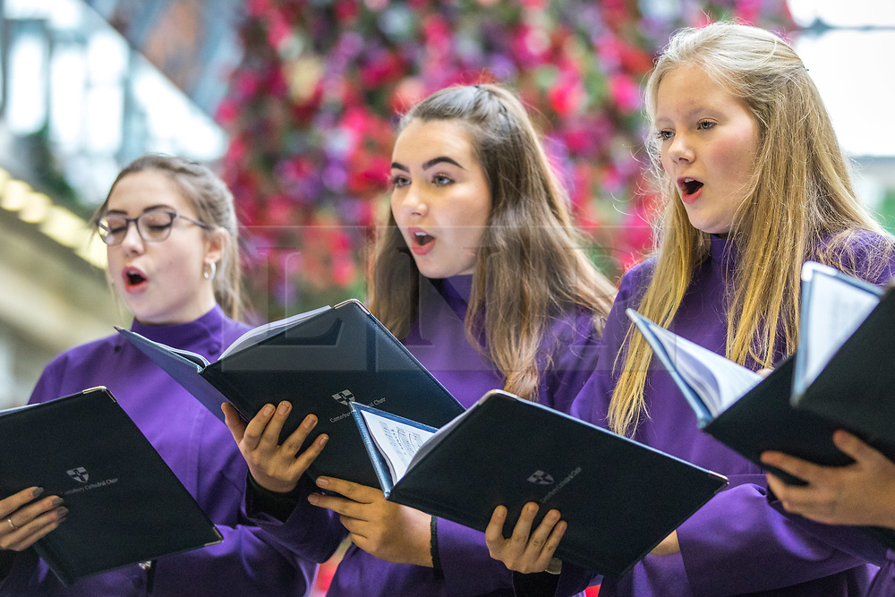 © Licensed to London News Pictures. 02/12/2017. London, UK. Canterbury Cathedral Girls' Choir perform Christmas Carols in the concourse at London's St Pancras station. Photo credit: Rob Pinney/LNP