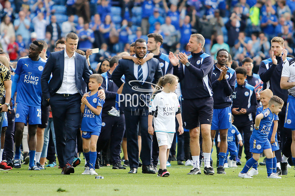 Leicester City squad and staff including Leicester City defender Wes Morgan and Leicester City defender Robert Huth parade around the pitch after the Premier League match between Leicester City and Bournemouth at the King Power Stadium, Leicester, England on 21 May 2017. Photo by Richard Holmes.