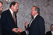 National Security Advisor Anthony Lake speaks with Senator Richard Shelby before testifying in the Senate Intelligence Committee hearing on his nomination as Director of the CIA March 11, 1997.