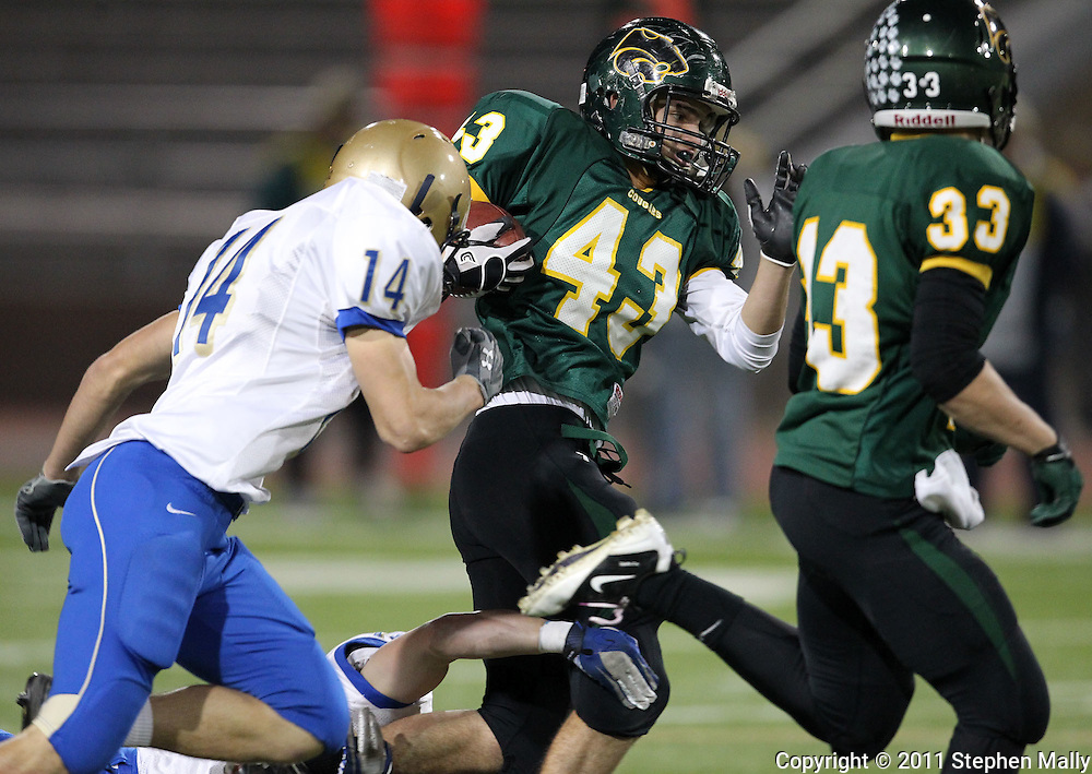 Kennedy's Jacob Frazier-Flores (43) runs with the ball during the first half of the game between Cedar Rapids Kennedy and Dubuque Wahlert at Kingston Stadium in Cedar Rapids on Friday night, October 21, 2011.