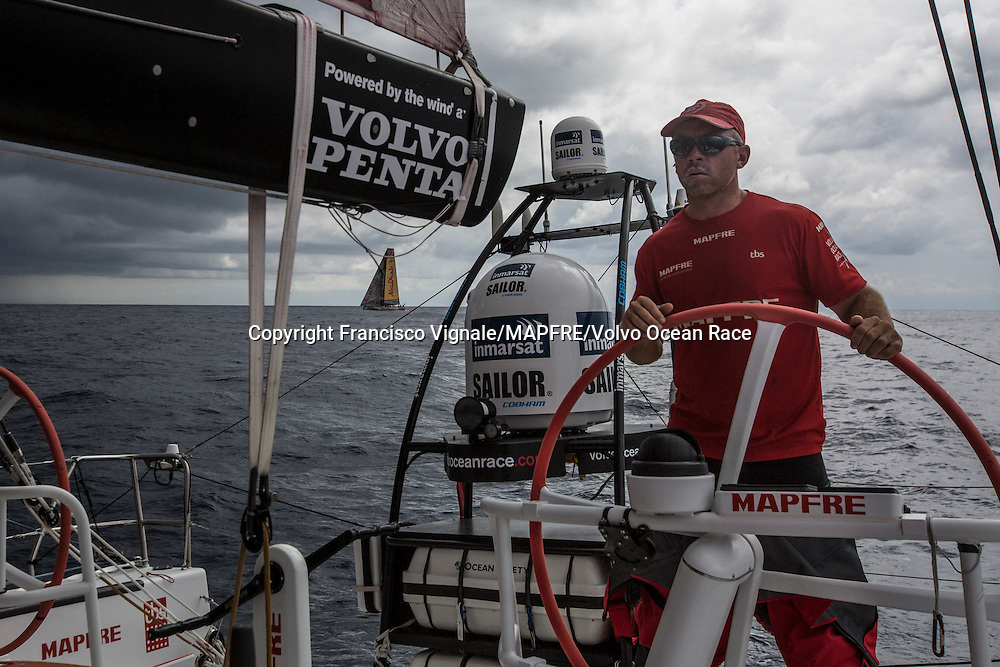 February 12, 2015. Leg 4 too Auckland onboard MAPFRE. Day 4. Abu Dhabi tacked after very shifty wind, Rob Greenhalgh helming and trying to find out from where the wind came from.