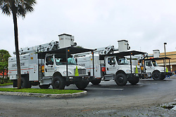 October 7, 2016 - Riviera Beach, Florida, U.S. - Asplundh trucks sit in the Poinciana Plaza in Riviera Beach waiting for assignments in the aftermath of Hurricane Matthew on Friday, October 7, 2016. (Credit Image: © Joe Forzano/The Palm Beach Post via ZUMA Wire)