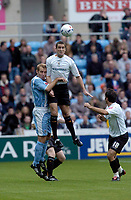 Photo: Leigh Quinnell.<br /> Coventry City v Luton Town. Coca Cola Championship.<br /> 29/10/2005. Lutons Chris Coyne rises above Coventrys James Scowcroft.