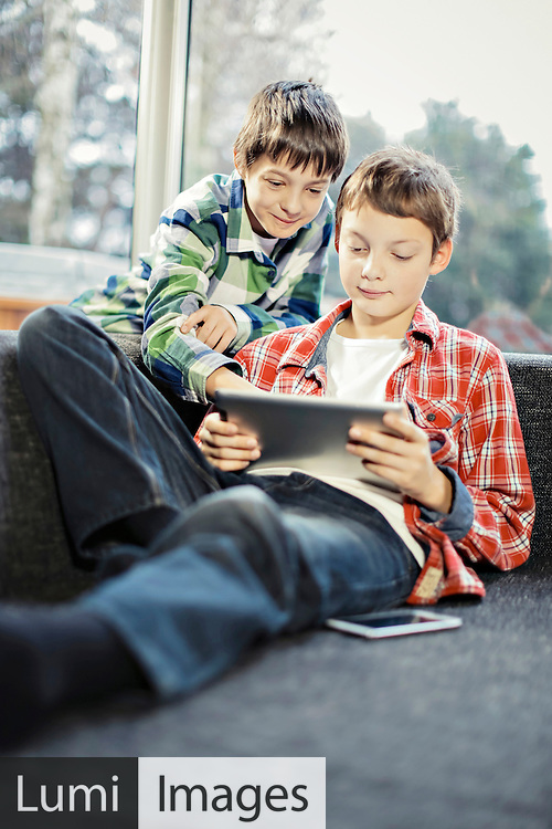 Two boys using digital tablet, Osijek, Croatia, Europe