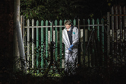 © Licensed to London News Pictures . 30/12/2013 . Manchester , UK . Police and forensic examiners cut away at metal fencing with power tools at the scene believed to be where Adam Pickup's body has been discovered , overlooking the Bridgewater Canal near to Deansgate Train Station in Manchester City Centre . The search for 17 year old Adam Pickup who was last seen in the early hours of Saturday 28th December . Photo credit : Joel Goodman/LNP