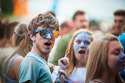 Festivalgoers covered in coloured powder at the Brownstock Festival in Essex.