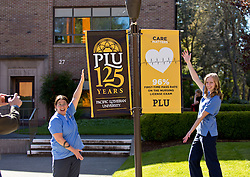 Soon to be nursing graduates Monica Hashiguchi '15, left and Catheryne Ekse '16, right pose for Catheryne's dad Dave Ekse for a early graduation photo on a warm spring day at PLU on Thursday, April 16, 2015. (Photo: John Froschauer/PLU)