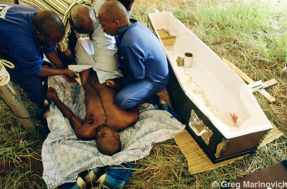 ANC supporters prepare a body back from autopsy at a funeral for a member killed by Inkatha Freedom Party members  in fighting with ANC supporters, KwaZulu Natal, South Africa. 1993