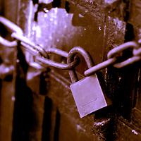 A padlock on an old door