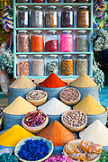Assorted spice stand with jars of aromatic and culinary herbs, spices and dried flowers at Place Rahba Lakdima - the spice square, Marrakech, Southern Morocco, 2018–02-19.