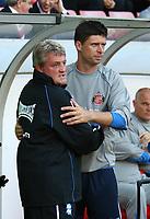 Photo: Andrew Unwin.<br /> Sunderland v Birmingham City. Coca Cola Championship. 09/08/2006.<br /> Birmingham's Steve Bruce (L) embraces Sunderland's Niall Quinn (R) before the game.