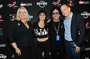 Canadian electro-pop singer Lights, center left, founding member of KISS Peter Criss, center right, Stephanie Kauffman, of Breast Cancer Research Foundation, and John Galloway, Chief Marketing Officer, Hard Rock International, pose on the PINK carpet at Hard Rock Cafe New York to launch PINKTOBER, Hard Rock's 15th annual breast cancer awareness campaign, Tuesday, Sept. 30, 2014.   (Photo by Diane Bondareff/Invision for Hard Rock International/AP Images)