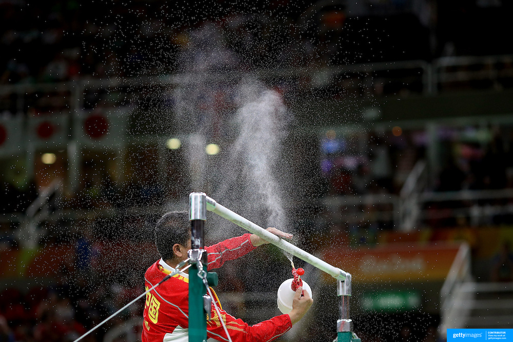 Gymnastics - Olympics: Day 4  A Chinese coach prepares the Horizontal bar for competition during the Artistic Gymnastics Women's Team Final at the Rio Olympic Arena on August 9, 2016 in Rio de Janeiro, Brazil. (Photo by Tim Clayton/Corbis via Getty Images)