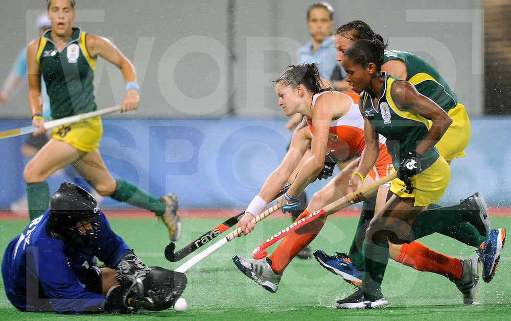 Beijing Olympic Green Hockey Stadium - Hockey.Netherlands - South Africa 6-0.Lidewij Welten stopped by  goalkeeper Mariette RIX ..photo:wsp/Frank Uijlenbroek.