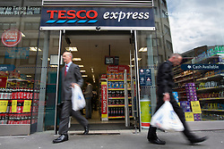 "© under license to London News Pictures. 09/12/14. FILE PICTURE: Tesco has warned today 9th December 2014, its full-year profits will be substantially below market expectations. The supermarket chain said its group trading profit for the full financial year ""will not exceed £1.4bn"", below the £1.8bn to £2.2bn range expected by markets. The downgraded guidance follows its admission earlier this year that it had misstated its profits by £263m. Picture credit Tolga Akmen/LNP"