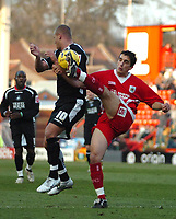Photo: Ed Godden.<br />Bristol City v Swansea. Coca Cola League 1. 28/01/2006.<br />Swansea's Lee Trundle (L) gets the ball and a boot in the face.
