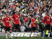 Photo: Lee Earle.<br /> Portsmouth v Manchester United. The Barclays Premiership. 07/04/2007.United's Paul Scholes (L), Rio Ferdinand and Ryan Giggs (R) look dejected after Portsmouth scored their second.
