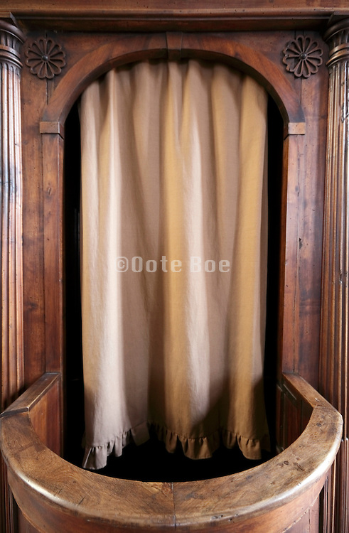 close up of a confessional with closed curtain
