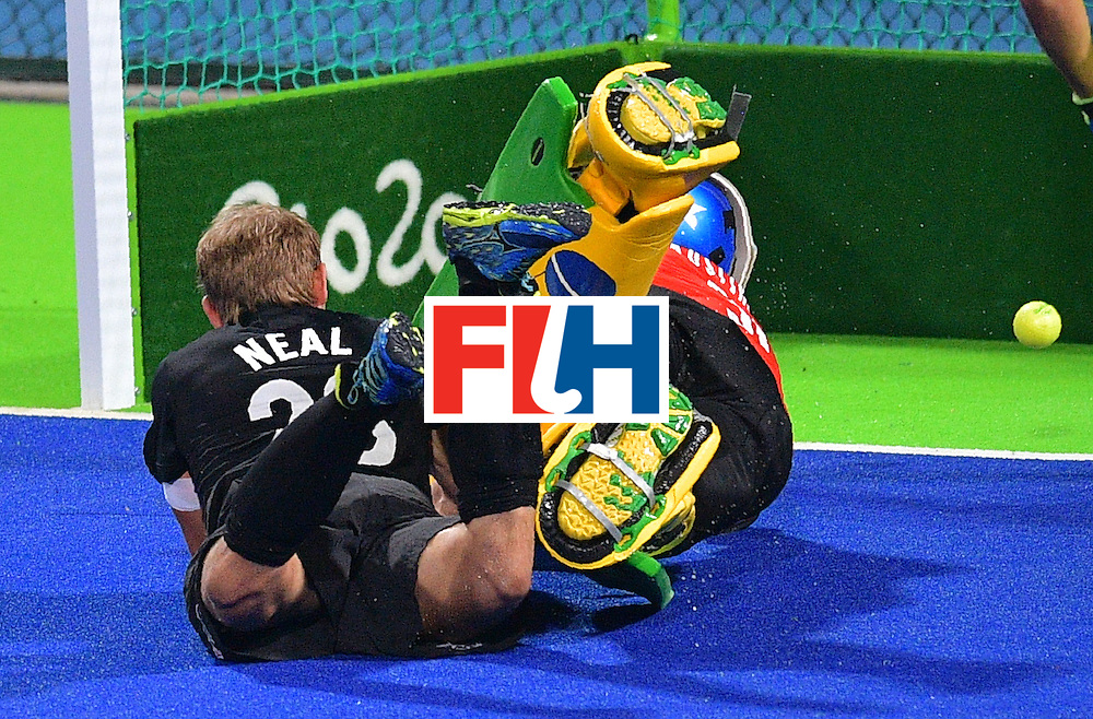 New Zealand's Shay Neal (L) scores a goal during the men's field hockey New Zealand vs Brazil match of the Rio 2016 Olympics Games at the Olympic Hockey Centre in Rio de Janeiro on August, 10 2016. / AFP / Carl DE SOUZA        (Photo credit should read CARL DE SOUZA/AFP/Getty Images)