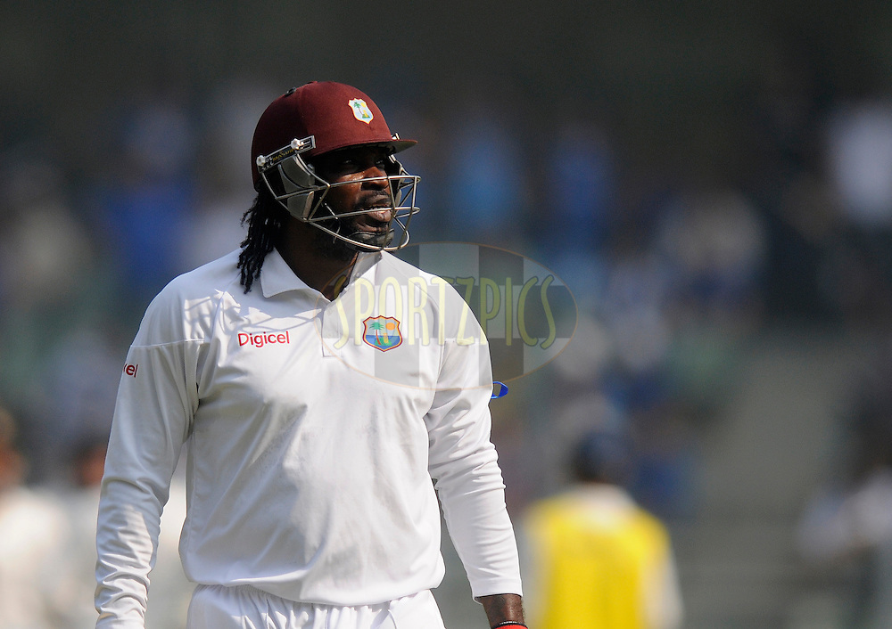 Chris Gayl of West Indies walks back after getting out during day one of the second Star Sports test match between India and The West Indies held at The Wankhede Stadium in Mumbai, India on the 14th November 2013<br /> <br /> This test match is the 200th test match for Sachin Tendulkar and his last for India.  After a career spanning more than 24yrs Sachin is retiring from cricket and this test match is his last appearance on the field of play.<br /> <br /> Photo by: Pal PIllai - BCCI - SPORTZPICS<br /> <br /> Use of this image is subject to the terms and conditions as outlined by the BCCI. These terms can be found by following this link:<br /> <br /> http://sportzpics.photoshelter.com/gallery/BCCI-Image-Terms/G0000ahUVIIEBQ84/C0000whs75.ajndY