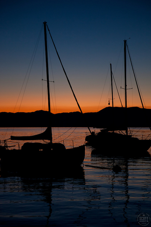 """""""Tahoe Sailboats at Sunrise"""" - These silhouettes of sailboats were photographed at sunrise on Lake Tahoe."""