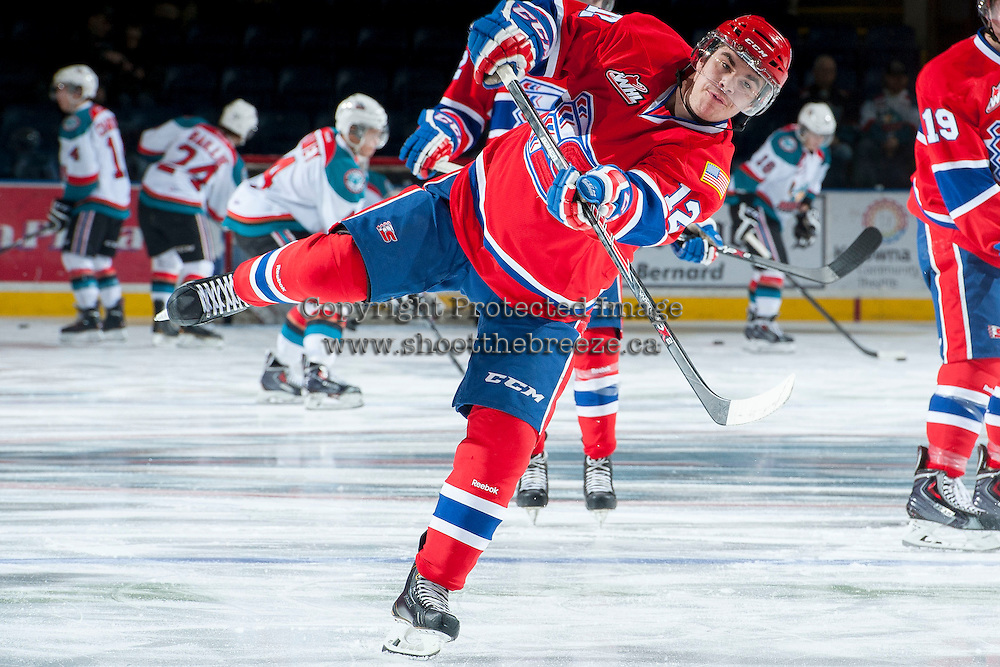 KELOWNA, CANADA -JANUARY 29: Markson Bechtold LW #12 of the Spokane Chiefs takes a shot during warm up against the Kelowna Rockets on January 29, 2014 at Prospera Place in Kelowna, British Columbia, Canada.   (Photo by Marissa Baecker/Getty Images)  *** Local Caption *** Markson Bechtold;