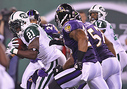 Sept 13, 2011; East Rutherford, NJ, USA; New York Jets running back LaDainian Tomlinson (21) runs with the ball during the second half of their game against the Baltimore Ravens at the New Meadowlands Stadium.  The Ravens defeated the Jets 10-9.