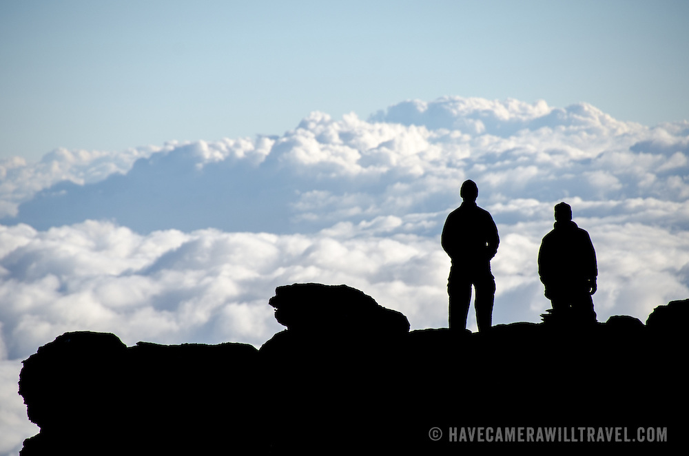 Two climbers look out over the clouds from Lava Tower (15,215 feet) on Mt Kilimanjaro's Lemosho Route.