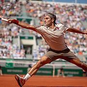 PARIS, FRANCE May 31.  Roger Federer of Switzerland in action against Casper Ruud of Norway during the Men's Singles third round match on Court Suzanne Lenglen at the 2019 French Open Tennis Tournament at Roland Garros on May 31st 2019 in Paris, France. (Photo by Tim Clayton/Corbis via Getty Images)