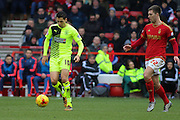 Huddersfield Town midfielder Karim Matmour on the ball ahead of Nottingham Forest midfielder Gary Gardner during the Sky Bet Championship match between Nottingham Forest and Huddersfield Town at the City Ground, Nottingham, England on 13 February 2016. Photo by Aaron  Lupton.