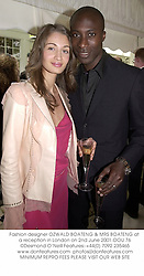 Fashion designer OZWALD BOATENG & MRS BOATENG at a reception in London on 2nd June 2001.	OOU 76
