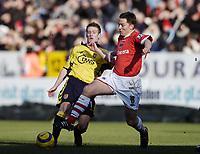 Photo: Olly Greenwood.<br />Charlton Athletic v Aston Villa. The Barclays Premiership. 25/02/2006.<br />Charlton's Matt Holland (R) and Aston Villa's Steven Davis go for the ball.