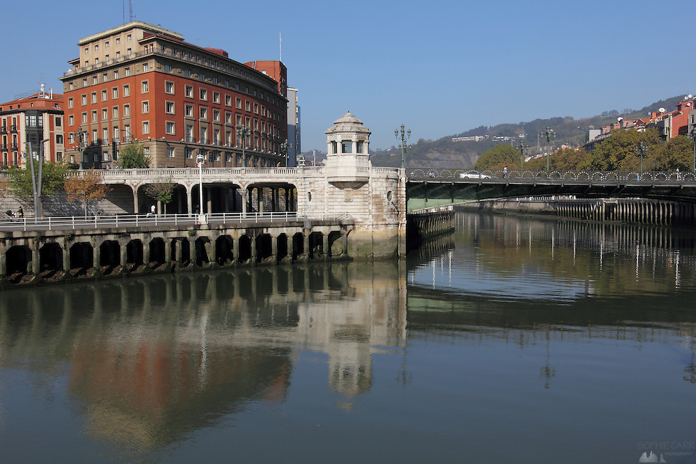 Reflections of old buildings in the river Nervión in Bilbao