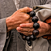 Close up of hands of Korean Buddhist Monk holding pray beads during the Korean Day Parade on the first Saturday of October.
