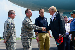 September 2, 2017 - Houston, TX, United States of America - U.S. President Donald Trump shakes hands with Col. Gary Jones, commander of the 147th Attack Wing, upon his arrival on Air Force One to Ellington Field Joint Reserve Base September 2, 2017 in Houston, Texas. The President plans to survey damage and visit communities effected by Hurricane Harvey. (Credit Image: © Sean Cowher/Planet Pix via ZUMA Wire)