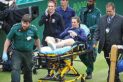JAMES WARD GAME STOPPED AS BALL GIRL DISLICATES HER KNEE AND GETS AN APPLAUSE AS SHE IS STRETCHERED OFF COURT, The Boddles Tennis Tournament,  Stoke Park Bucks, 29th June 2017<br /> Photo:Mike Capps