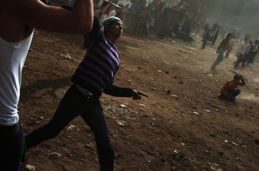Anti-government protesters throw stones at Mubarak supporters in Tahrir Square in Cairo, Egypt on February 3, 2011. Egypt erupted in mass protests on Jan. 25, 2011 with protesters demanding President Mubarak step down from power, chanting that they will not leave Tahrir Square until Mubarak leaves office. Mr. Mubarak has said he will not run for reelection but has refused to step down from power, and has sent his armed supporters to violently attack the crowds of protesters. Human rights organizations report that at least 150 people have been killed since the protests began.