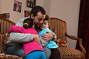 CAIRO, EGYPT - FEBRUARY 25: Al Jazeera English (AJE) producer Baher Mohamed (c) gets a hug from his daughter Fairouz (l) and son Hazem  February 25, 2015 at his family apartment in the Sheikh Zayed district on the outskirts of Cairo, Egypt. Baher, and fellow Al Jazeera defendent Mohamed Fahmy were conditionally released on Feb 12, 2015 following Egypt's highest appeal courts decision to grant them a retrial, which has since been postponed until March 8. (Photo by Scott Nelson, for the Washington Post)