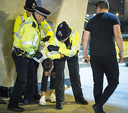 © Licensed to London News Pictures . 01/11/2015 . Manchester , UK . Police detain and handcuff a man on Deansgate Locks before taking him in to the back of a police van . Halloween revellers , wearing make up and costumes , out and about in Manchester City Centre . Photo credit : Joel Goodman/LNP