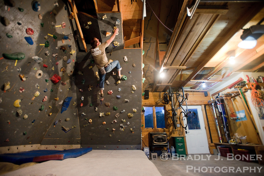 Trevor Deighton works out on the climbing wall in the garage of his Victor, Idaho, home on a warm October evening.