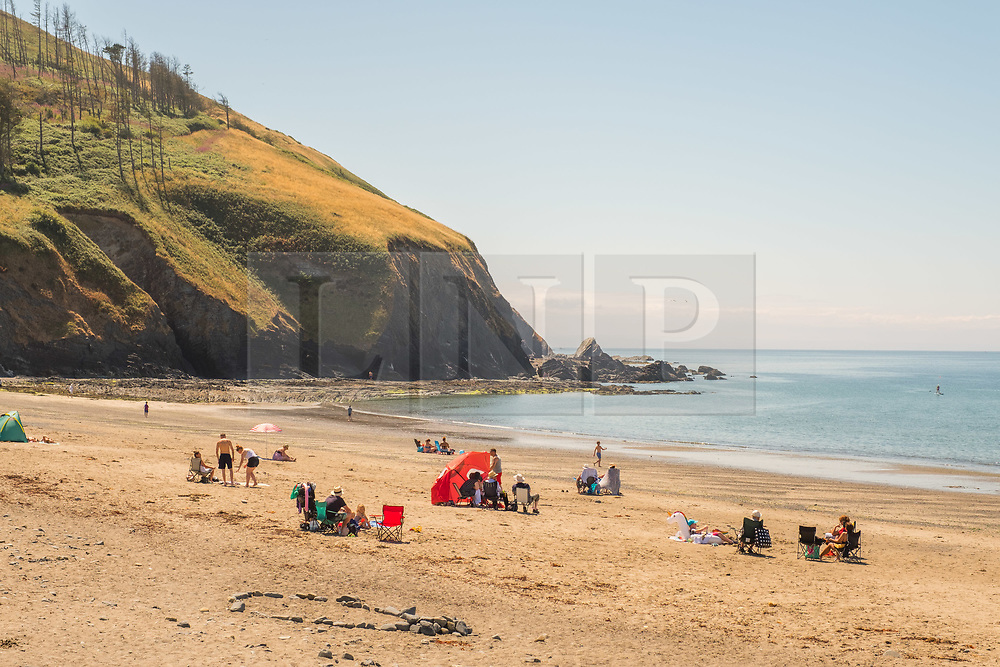 © Licenced to London News Pictures. <br /> Clarach Bay,UK, Sunday 22//07/2018. People enjoying themselves on the beach at Clarach Bay near Aberystwyth on a gloriously sunny Sunday afternoon in west wales. <br /> The UK wide heatwave continues, with no respite from the very dry weather and temperatures are expected to exceed 30ºc again by the end of the week. Photo credit: Keith Morris/LNP
