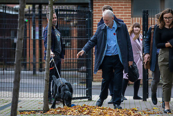 © Licensed to London News Pictures. 02/11/2019. Swindon, UK. Labour Party Leader Jeremy Corbyn waves to a dog as he leaves Commonweal Sixth Form College in Swindon after a campaign rally ahead of the general election on 12 December. Photo credit: Rob Pinney/LNP