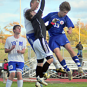 10/18/10 -- BATH, Maine. Mt Ararat Forward Alden Talbot crashes in on Morse Goalie Grady Madden on Monday afternoon in Bath. The Shipbuilder offense sputtered against the unpredictable Eagles. Mt Ararat carried the pace of the game - forcing Morse's defense to step up often. 2 goals late in the first half were enough to carry Mt. Ararat to victory. Final Score 2-0.   Photo by Roger S. Duncan.