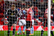 Aston Villa celebrate Aston Villa defender James Chester (5) goal to make the score 0-2, in the background as Sunderland goalkeeper Jason Steele (1) looks dejected and goes to pick the ball out of the net during the EFL Sky Bet Championship match between Sunderland and Aston Villa at the Stadium Of Light, Sunderland, England on 6 March 2018. Picture by Simon Davies.