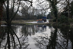 Denham, UK. 5 February, 2020. Engineers and security guards monitor fencing for land cleared at Buckinghamshire Golf Club in the Colne Valley for works planned in conjunction with the HS2 high-speed rail link including the felling of mature trees in a nature reserve on the other side of the river Colne and the construction of a Bailey bridge across the river. Environmental activists are occupying trees in Denham Country Park in an attempt to prevent or hinder the work.