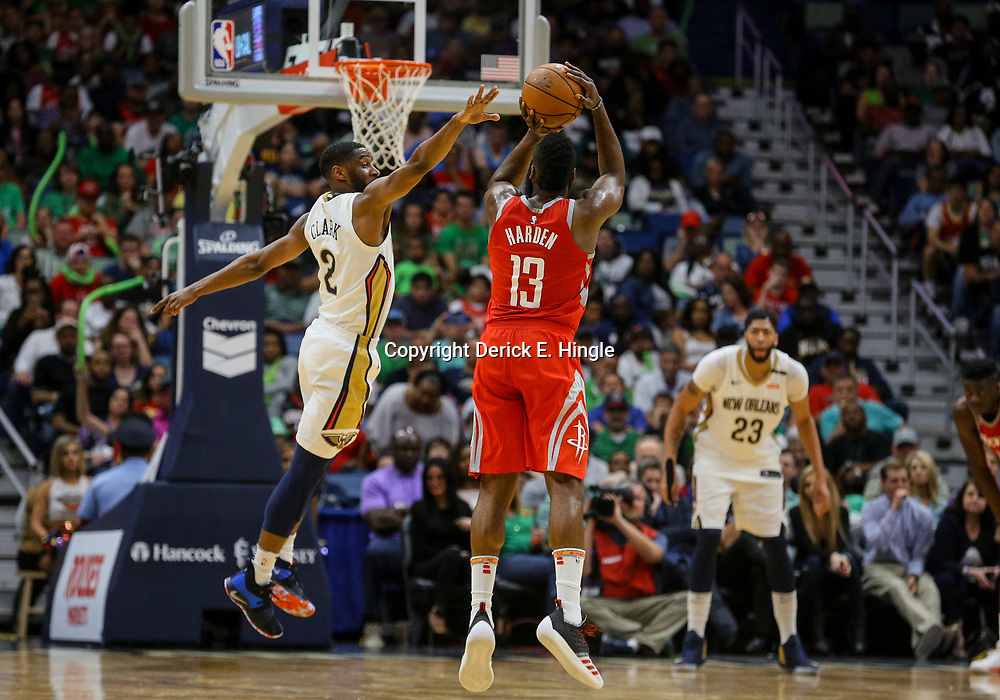 Mar 17, 2018; New Orleans, LA, USA; Houston Rockets guard James Harden (13) shoots a three pointer over New Orleans Pelicans guard Ian Clark (2) during the fourth quarter at the Smoothie King Center. The Rockets defeated the Pelicans 107-101. Mandatory Credit: Derick E. Hingle-USA TODAY Sports