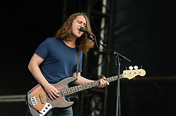© Licensed to London News Pictures. 23/08/2014. Reading, UK.   Pulled Apart By Horses performing live at Reading Festival 2014 on Saturday Day 2.    In this picture - Robert John Lee.  Photo credit : Richard Isaac/LNP