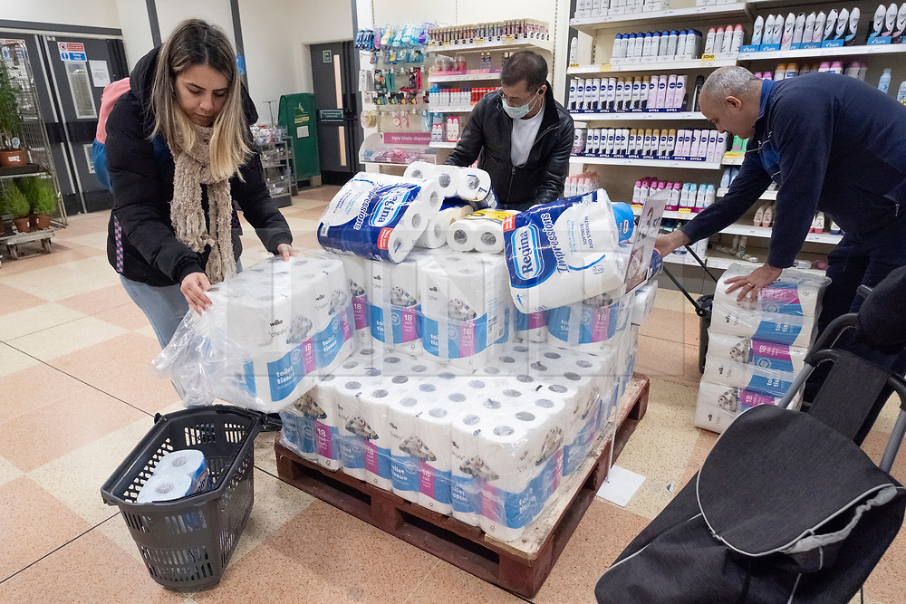 © Licensed to London News Pictures. 20/03/2020. London, UK.  Customers buy toilet paper at a Wilko store as panic buying sets in due the threat of Coronavirus spreading Photo credit: Ray Tang/LNP